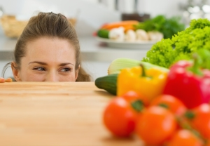 Young Woman Looking Out From Cutting Board And Looking On Vegeta